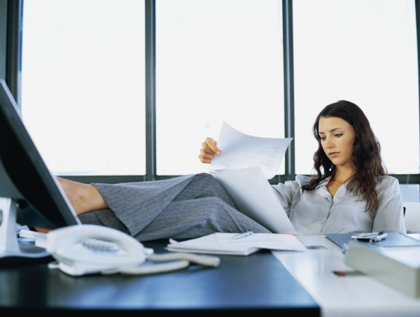 Businesswoman Reading Documents In An Office-w2